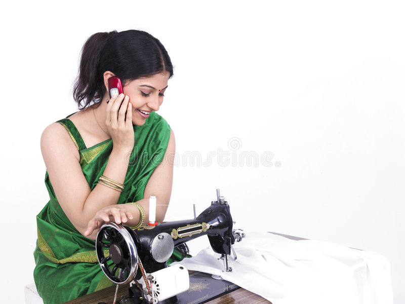 Download Asian Tailor Her Cell Phone Stock Image - Image of equipment, complexion: 7333481