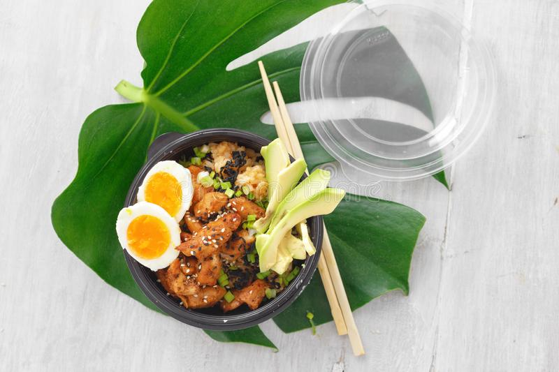 Asian take away food Two poke bowl fried rice chicken meat eggs box top view stock photo