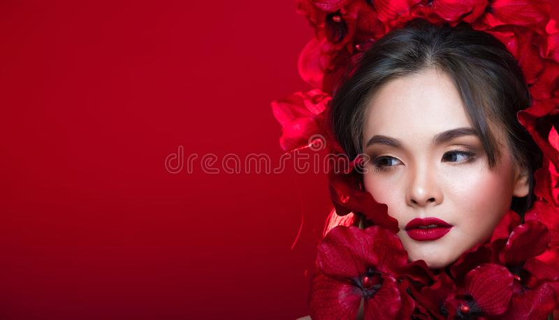 Asian tanned skin woman with strong color red lips. Fashion portrait of Asian Gray curl hair woman with strong color red lips, studio lighting red reddish royalty free stock photos