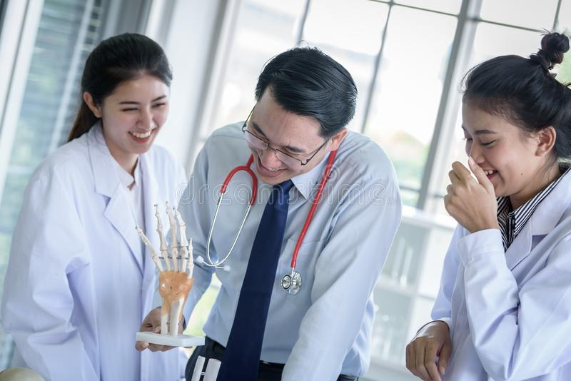 Asian teacher has teaching to student about science and anatomical in laboratory royalty free stock photos
