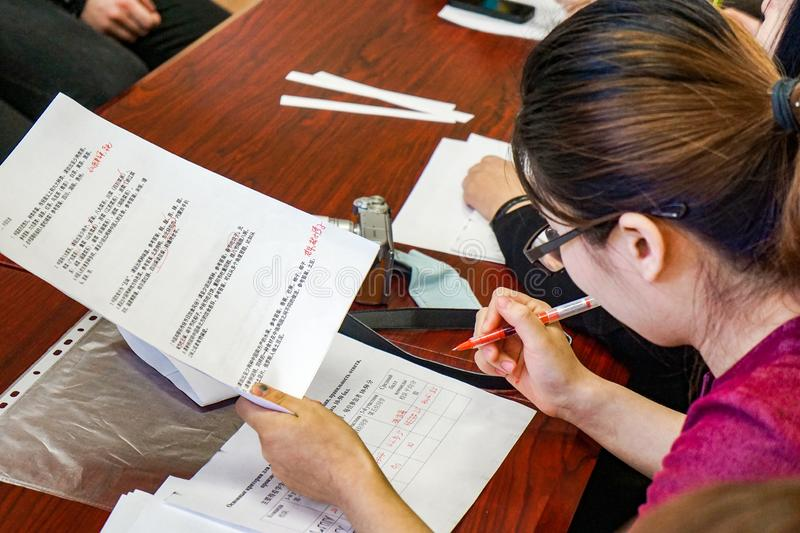 Asian teacher takes oral exam in chinese. stock images
