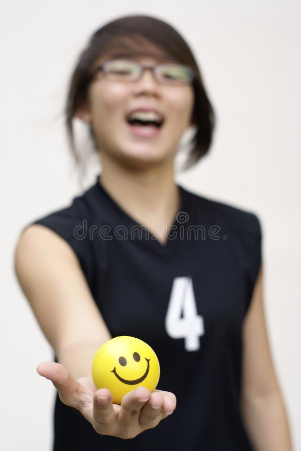 Asian teen girl with happy ball