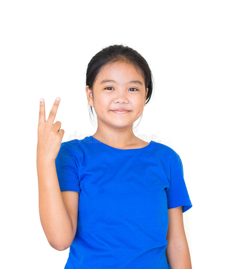 Asian teen showing finger victory gesture, She are happy and smile stock photography