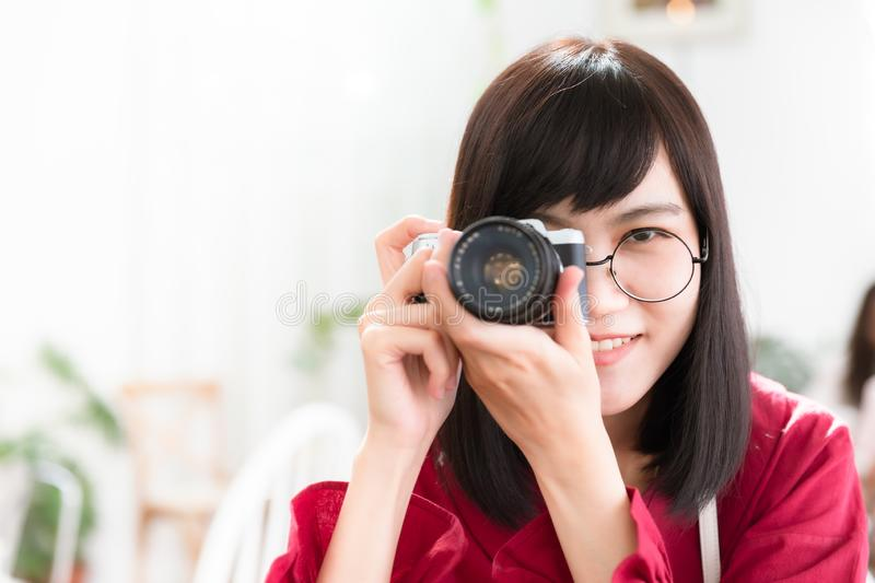 Asian teen young woman with camera stock photography