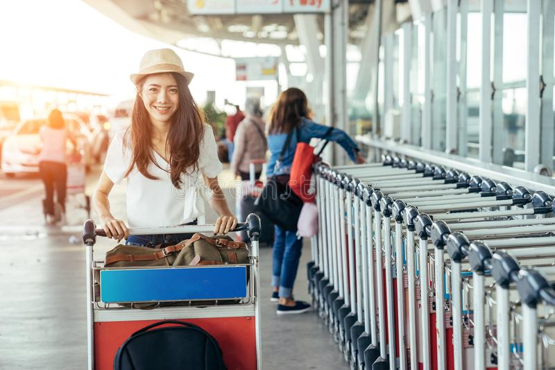 Asian teenage girl is carrying the bag stock photo
