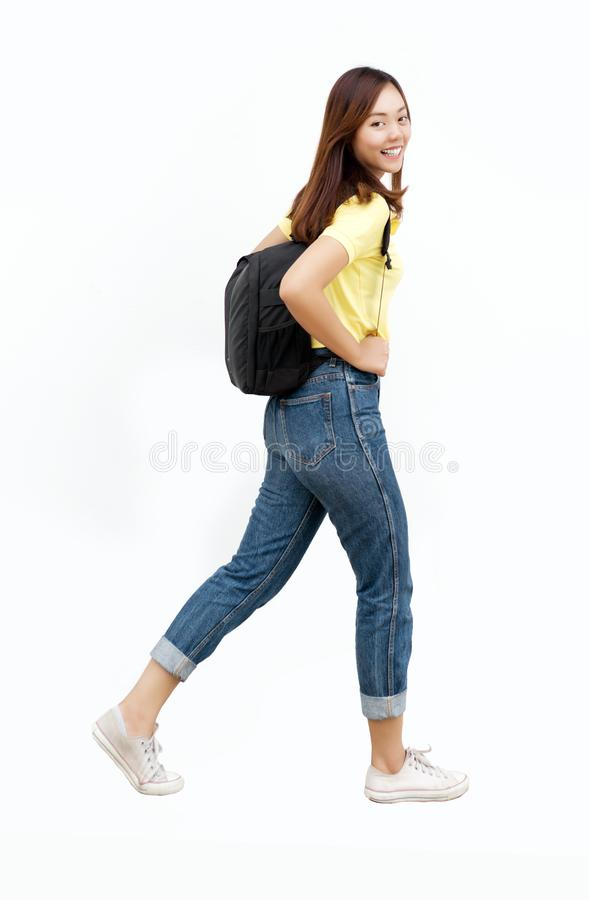 Asian teenage girl hold bag with backpack stock photo