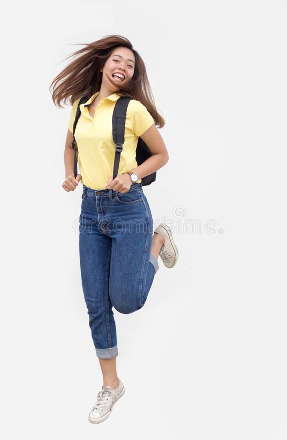 Asian teenage girl jump ping with backpack stock photography