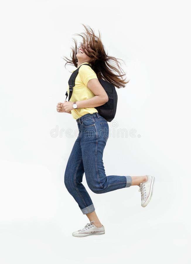 Asian teenage girl jump ping with backpack stock photo