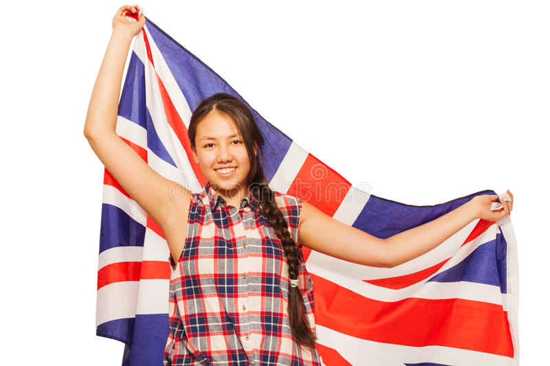 Asian teenage girl waving British flag behind her. Smiling Asian teenage girl waving British flag isolated on white royalty free stock photography