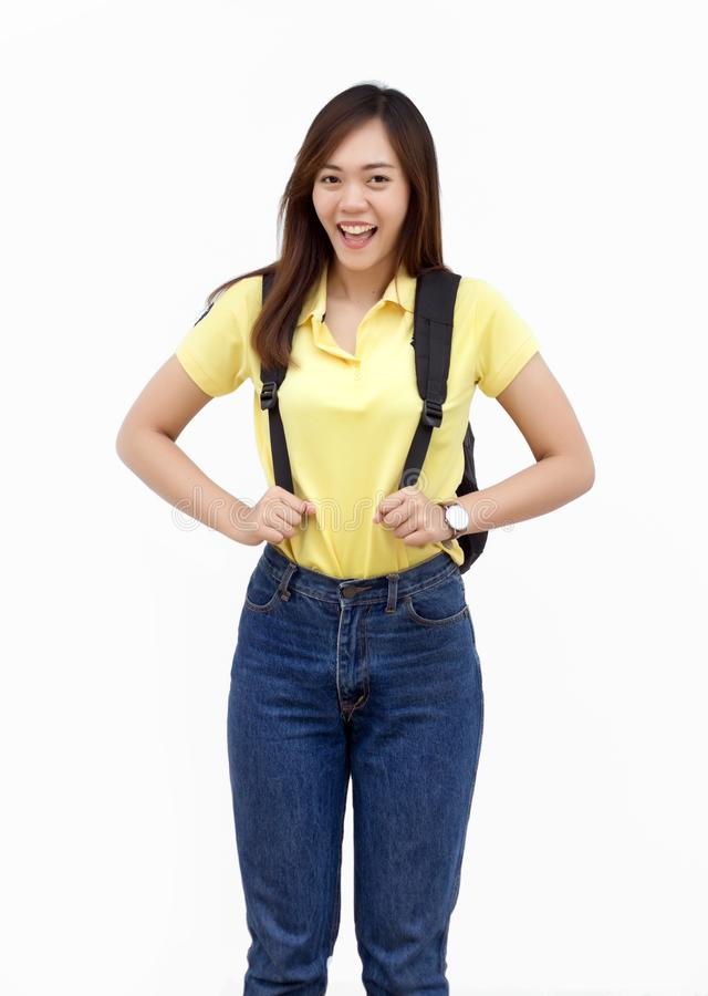 Asian teenage hold backpack belt and walk action on white stock images