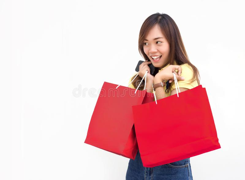 Asian teenage hold shoppping bag and walk action stock images