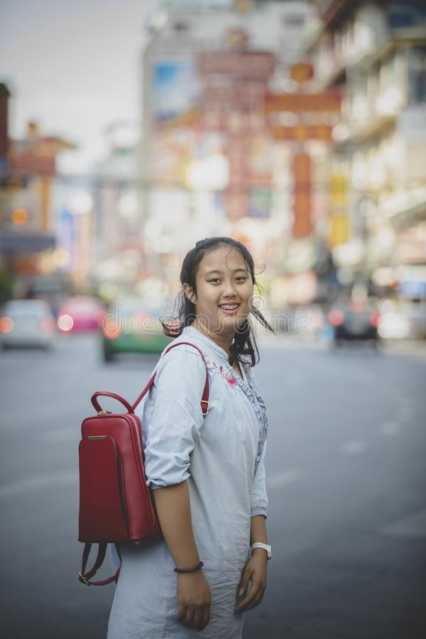 asian teenager carrying red backpack toothy smiling face happiness emotion in yaowaratch road bangkok thailand royalty free stock image