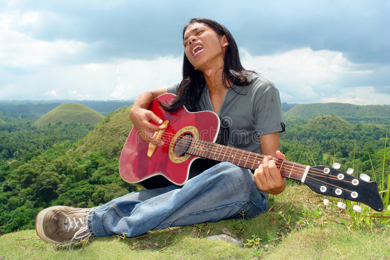 Asian teenager with guitar royalty free stock photo