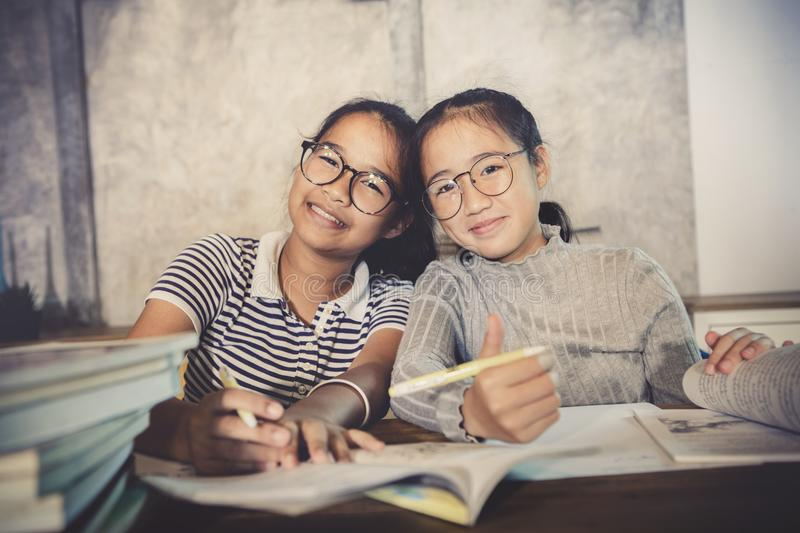 Asian teenager happiness emotion doing school home work stock images