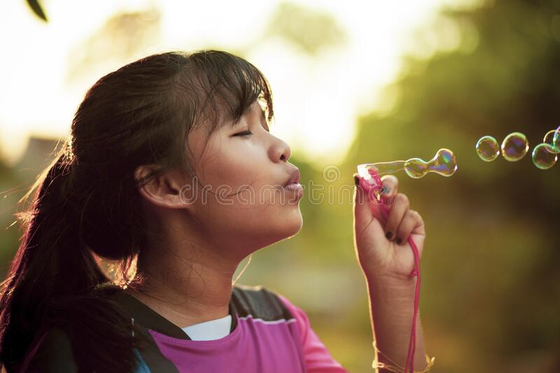 Asian teenager relaxing with soup bubble. Asian teenager relaxing with  soup bubble stock photo