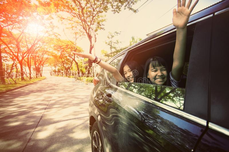 Asian teenager sitting in passenger car with happiness emotion ,family traveling theme royalty free stock images