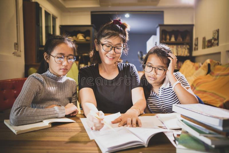 Asian teenager student and woman teacher toothy smiling face in modern class room. Asian teenager student and women  teacher toothy smiling face in modern class royalty free stock photo