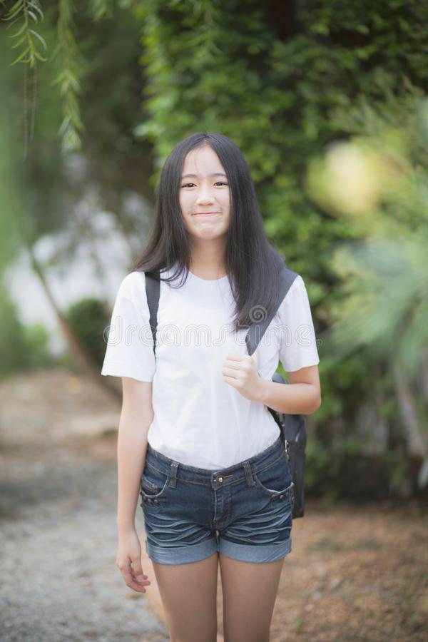 Asian teenager toothy smiling face happiness standing outdoor royalty free stock photography