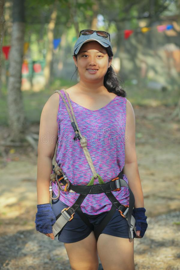 Asian teenager wearing safety harness suit preparing for playing stock photos