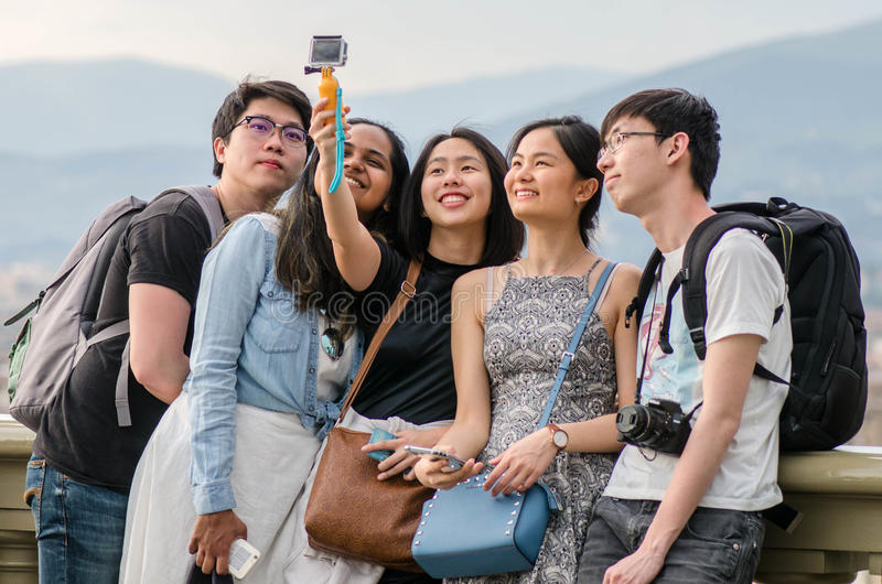 Asian teens taking pictures and selfies on royalty free stock images