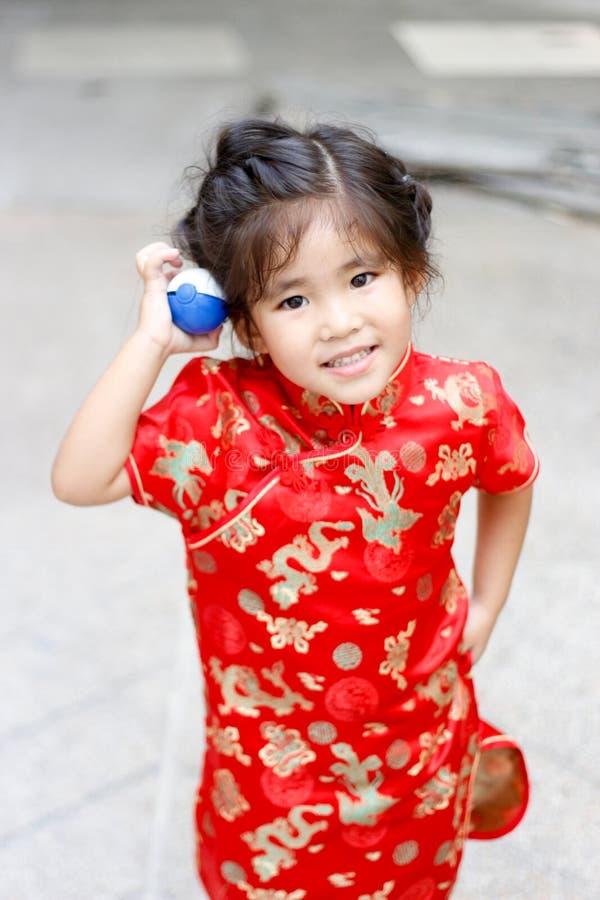 Asian Thai girl play pokemon ball. Asian thai girl smile play pokemon ball toy show funny action stock photos