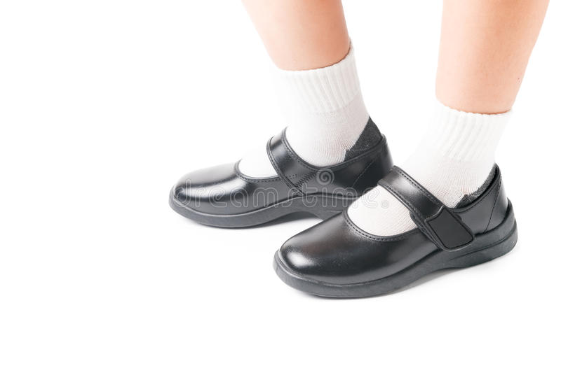 Asian Thai girls schoolgirl student wear a black leather shoes. royalty free stock photography