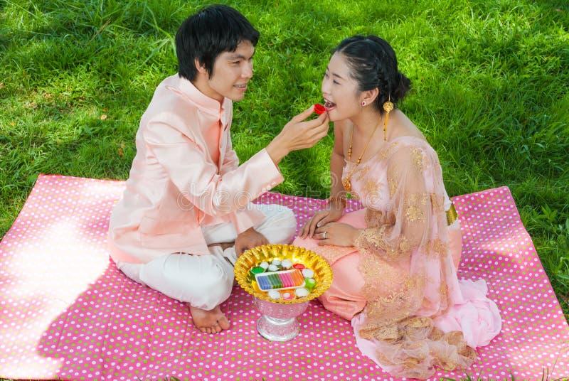 Download Asian Thai Groom Feeding His Cute Bride Stock Image - Image: 31195189