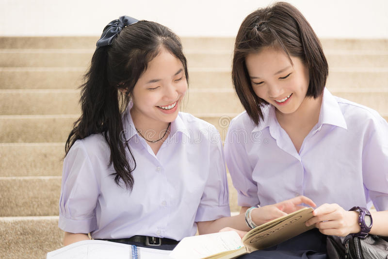 Asian Thai high schoolgirls student couple in school studying stock photos