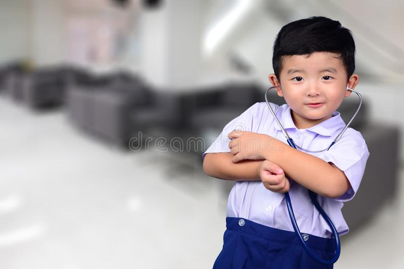 Asian Thai kid with medical stethoscope looking at camera, healthy concept stock images