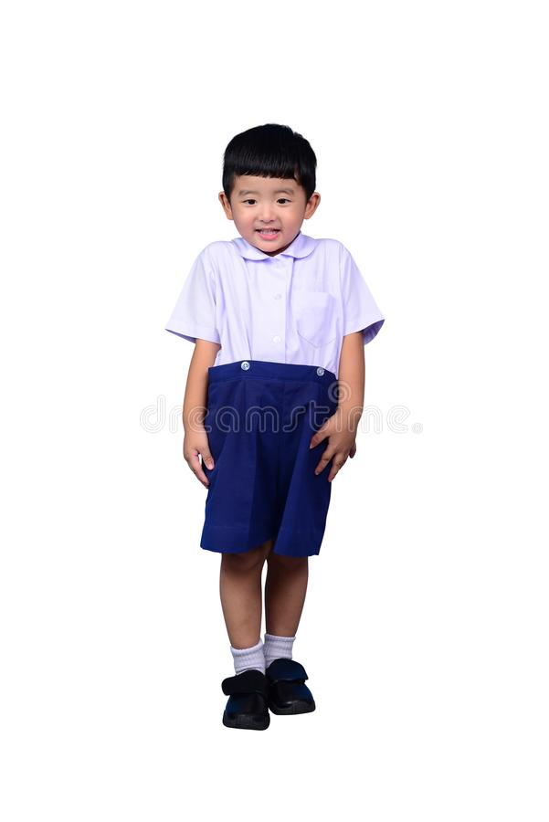 Asian Thai kindergarten student kid in school uniform isolated on white background stock photography