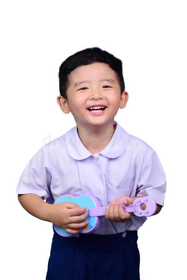 Asian Thai kindergarten student kid in school uniform playing to stock image