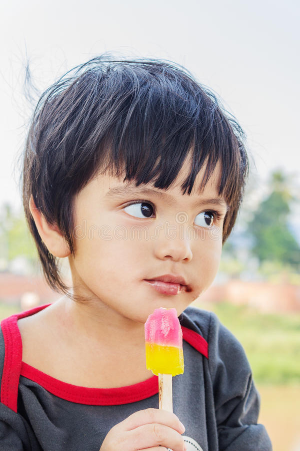 Asian Thai little boy eating ice cream stock images