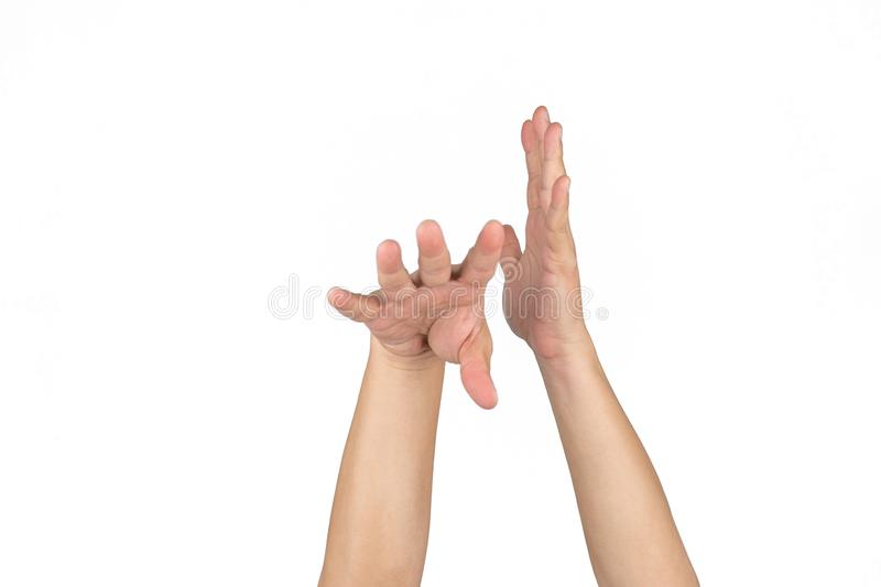 Asian Thai males hand posture shooting Basketball skill close up only to two hand after shot follow through the ball out  with royalty free stock image