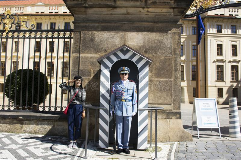 Asian thai woman posing for take photo with soldier in uniform standing at front of Prague castle stock images