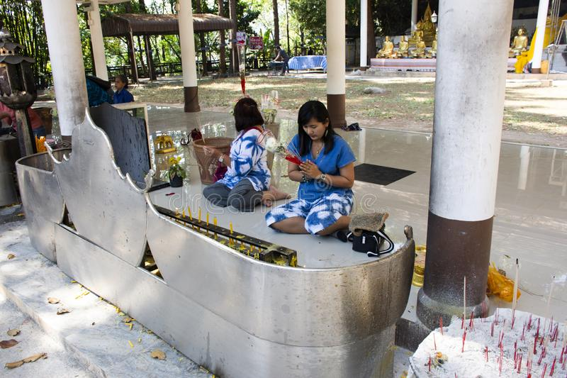 Asian thai women mother and daughter sit and respect praying buddha statue at Wat Phra That Doi Tung in Chiang Rai, Thailand royalty free stock images