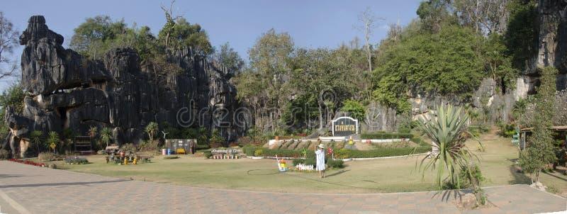 Asian thai women travel and shooting photo at viewpoint of Suan Hin Pha Ngam or Thailand`s Kunming royalty free stock photos