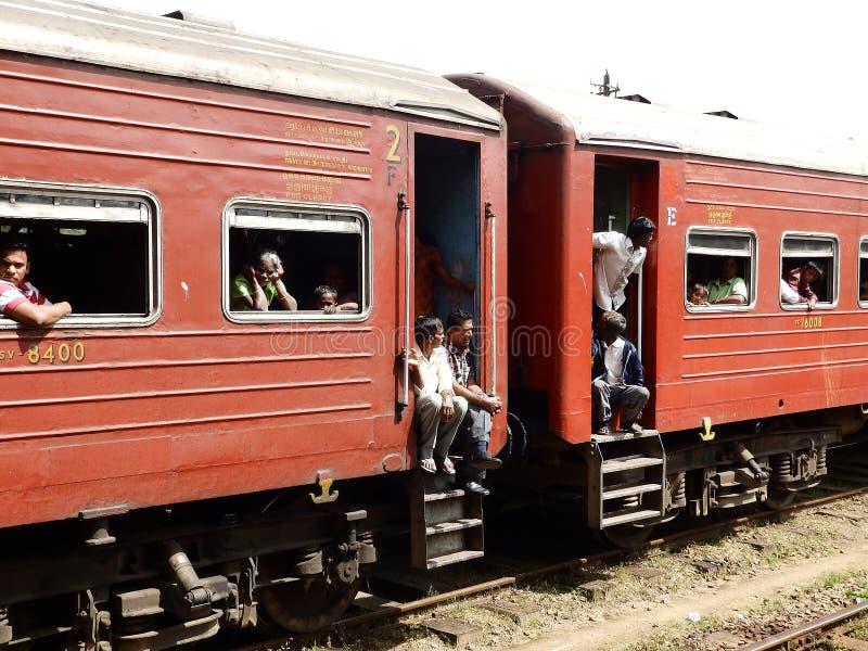 Asian third-class passengers in the red train, Sri Lanka stock image