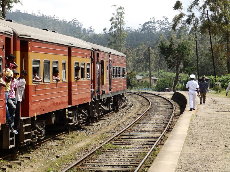Asian third-class passengers in the red train. Sri royalty free stock images