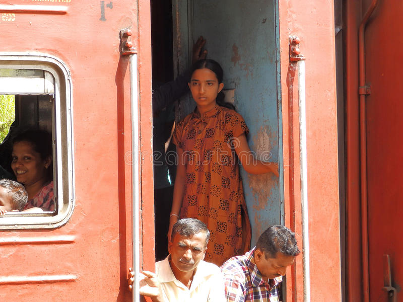 Asian third-class passengers in the red train. Sri stock photos