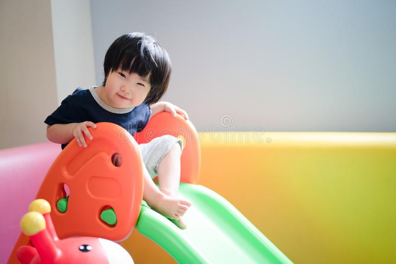 Asian toddler baby boy girl looking toward camera with a little smile royalty free stock photography