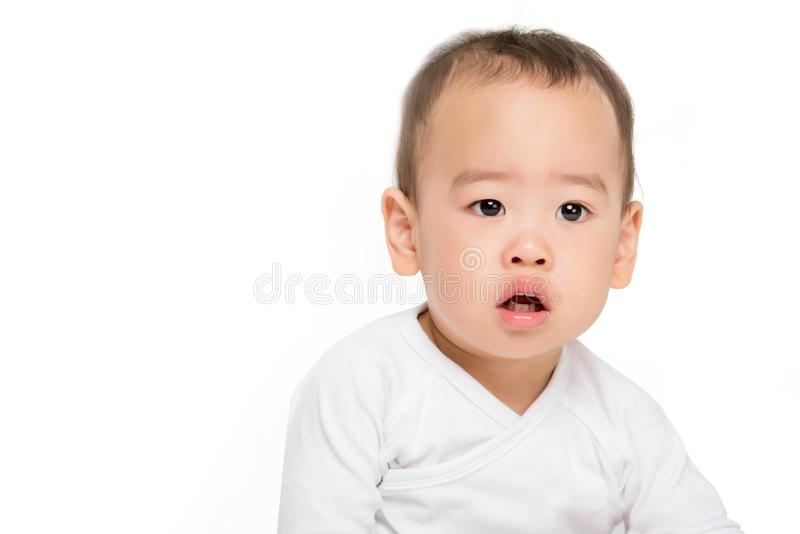 Asian toddler boy. Portrait of cute asian toddler boy looking away isolated on white royalty free stock image