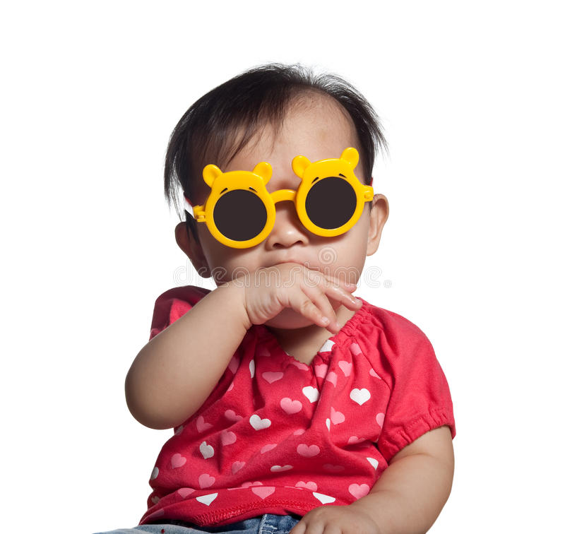 Asian toddler girl. Playful Asian toddler girl with sunglasses isolated on white background royalty free stock photos