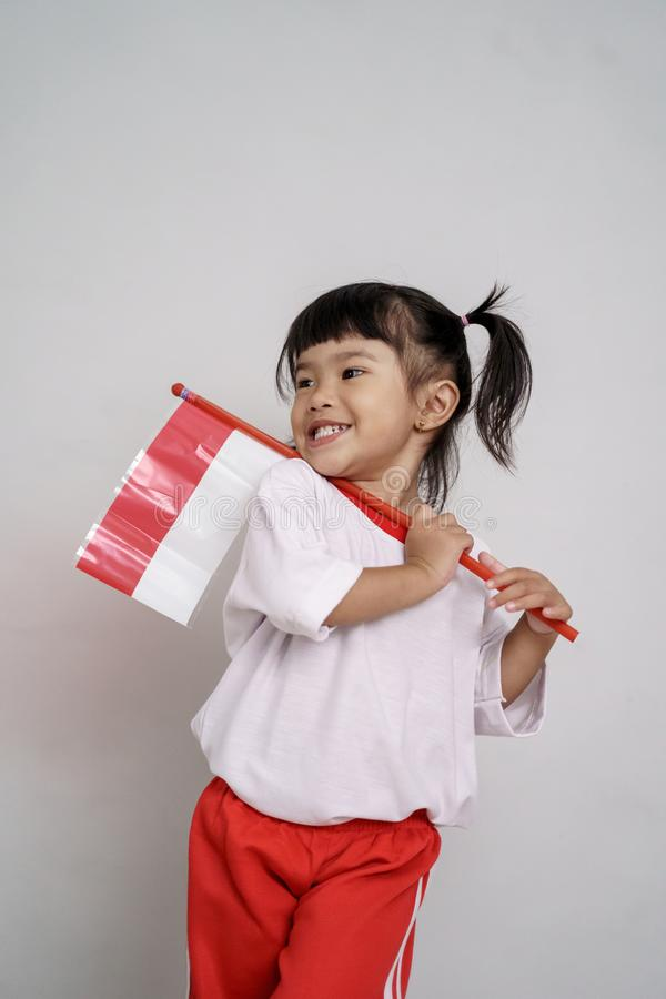 Asian toddler with indonesian flag smiling to camera. Over white background stock photos