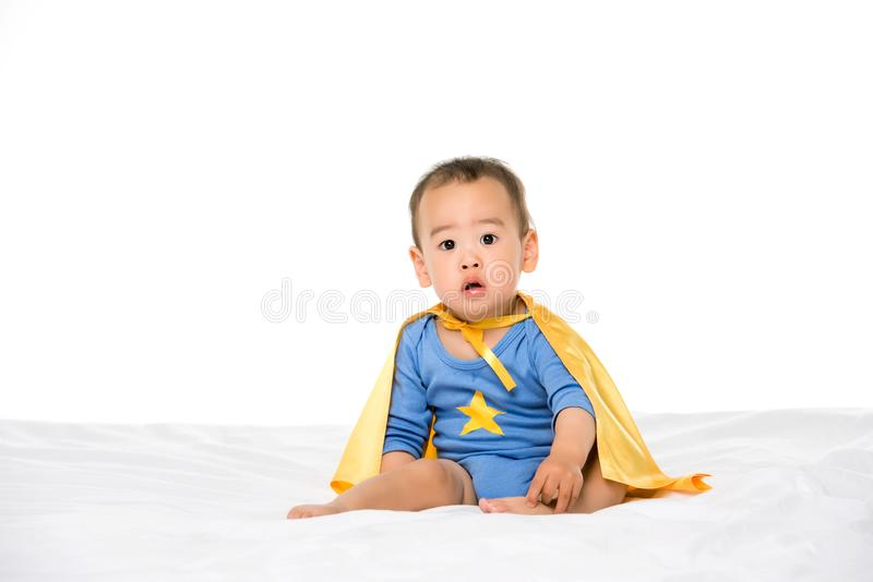 Asian toddler in superhero cape. Adorable asian toddler boy in superhero cape looking at camera isolated on white stock images