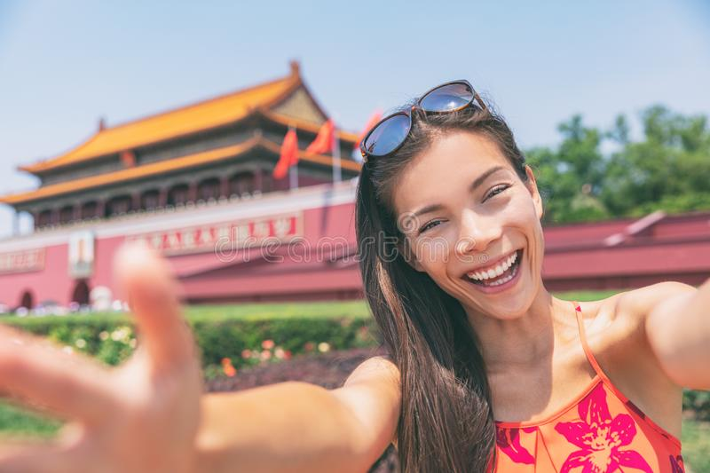 Asian tourist girl taking selfie photo with phone at Tiananmen Square in Beijing city, China. Asia chinese woman lifestyle. Asian tourist girl taking selfie stock images