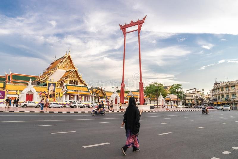 An Asian tourist is walking along street at the Giant swing or Sao Ching Cha the  landmark of bangkok city. Thailand: 03/07/2019 stock photos