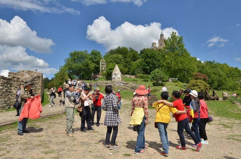 Asian tourists in Tsarevets fortress, Veliko Tarnovo, Bulgaria royalty free stock photo