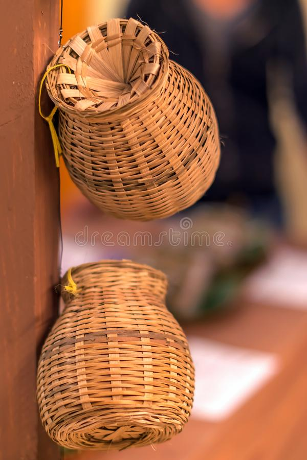 Asian traditional wicker baskets and Pitchers from Vietnamese. In the eastern bazaar. stock photos