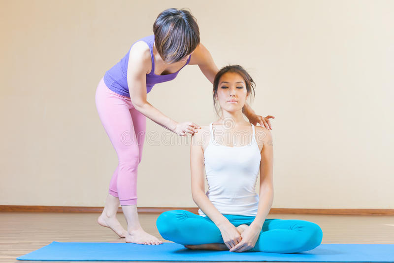Asian trainer conducts classes of group yoga indoor. At yoga class. Concept of a healthy lifestyle and the right attitude to life stock photo