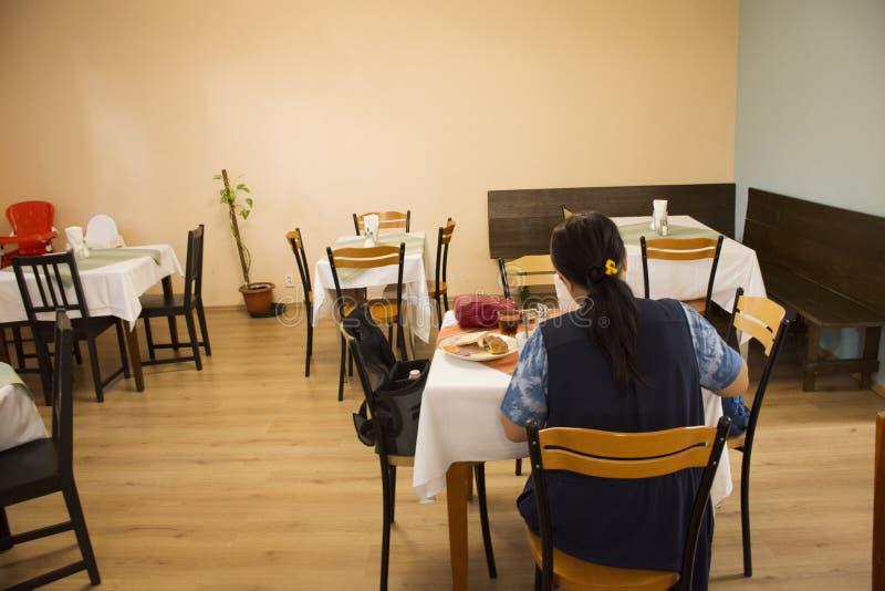 Asian travelers thai woman eating breakfast in restaurant room. Of resort hotel at Prague, Czech Republic stock photo